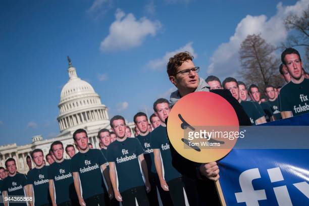 Joseph HuffHannon sets up a display of Facebook CEO Mark Zuckerberg cutouts on the east lawn of the Capitol ahead of his testimony before a joint...