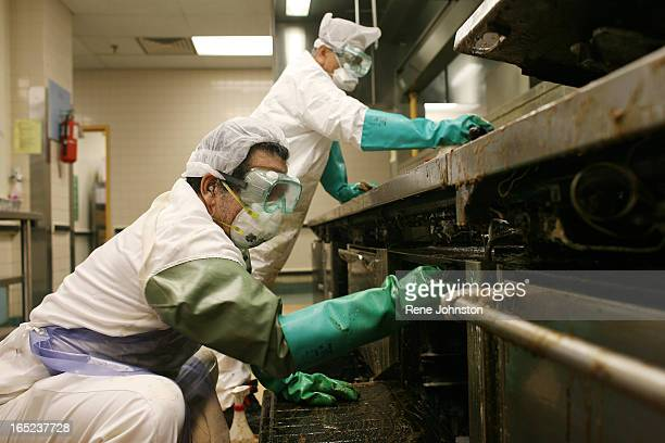 PREP Joseph Hugh and Eliseo LLanes scrub the cooking scum off of the grill Baycrest hospital takes the full industrial hospital kitchen apart and...