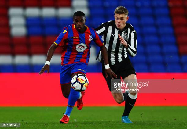 Joseph Hungbo of Crystal Palace avoids a challenge from Lewis Cass of Newcastle during the FA Youth Cup Fourth Round match between Crystal Palace and...