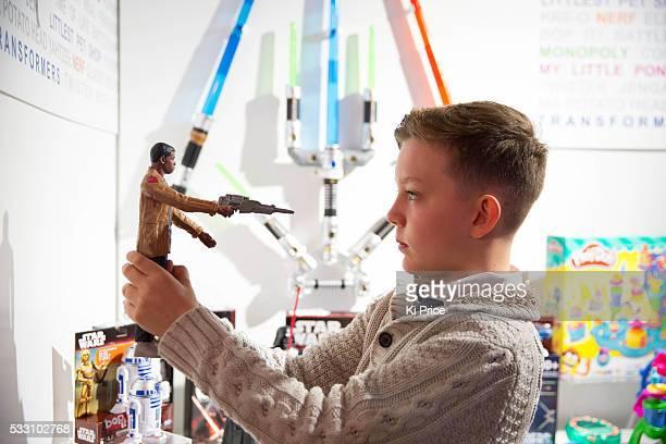 Joseph Irwin plays with Kylo Ren Finn The Force Awakens figures at Dream toys 2015 Photos Ki Price