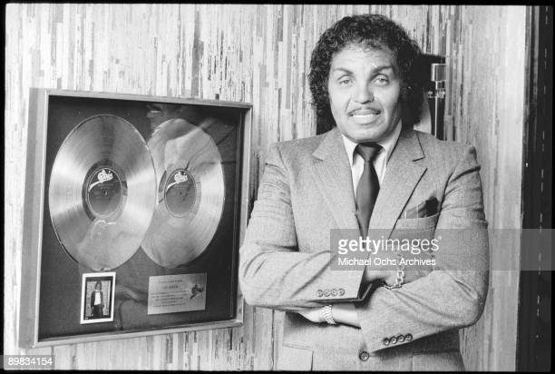 Joseph Jackson father and manager of The Jackson Five poses by an Epic double platinum award circa 1982