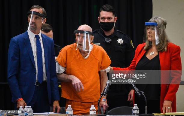 Joseph James DeAngelo center and his public defenders Joseph Cress left and Diane Howard right wear face shields as they stand as Sacramento Superior...