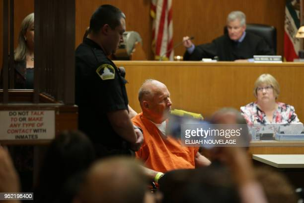Joseph James DeAngelo is taken on a wheel chair into the courtroom to be arraigned on two counts of murder April 27 in Sacramento California I...