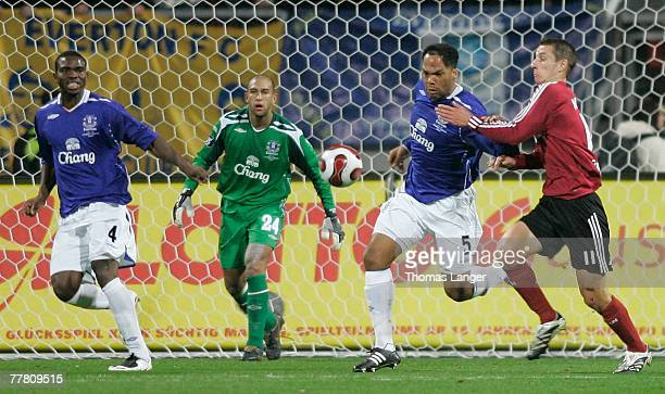 Joseph Jobo Timothy Howard and Joleon Lescott of Everton defend against Marek Mintal of Nuremberg during the UEFA Cup Group A match between 1 FC...