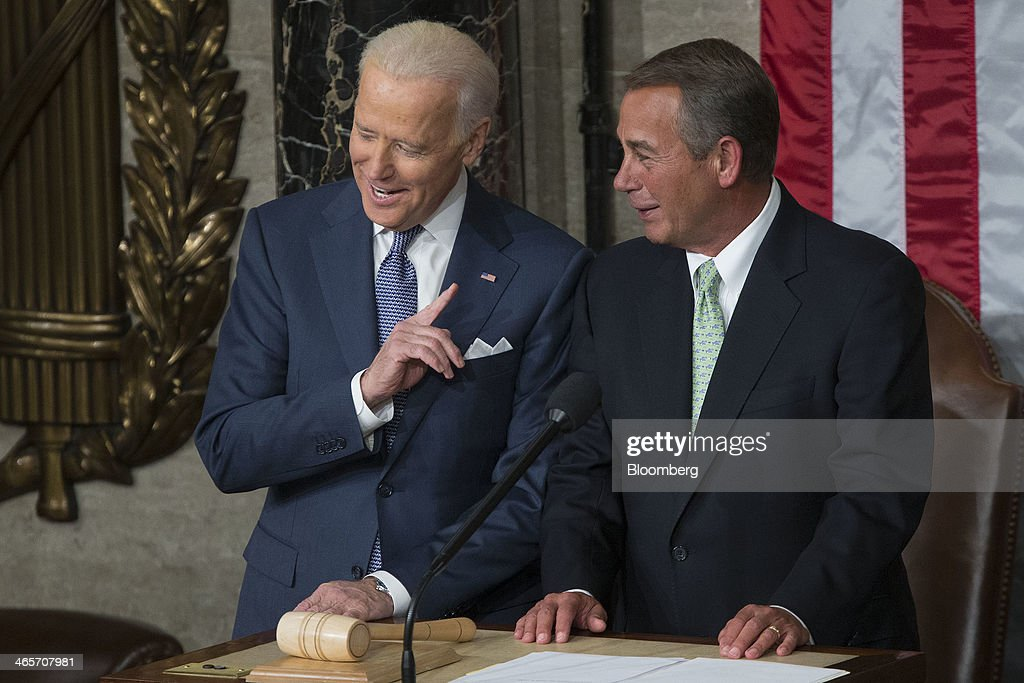 Joseph 'Joe' Biden, U.S. vice president, left, talks to House Speaker John Boehner, a Republican from Ohio, before U.S. President Barack Obama, not pictured, delivers the State of the Union address to a joint session of Congress at the Capitol in Washington, D.C., U.S., on Tuesday, Jan. 28, 2014. Obama offered modest steps to chip away at the country's economic and social challenges in a State of the Union address that reflects the limits of his power to sway Congress. Photographer: Andrew Harrer/Bloomberg via Getty Images