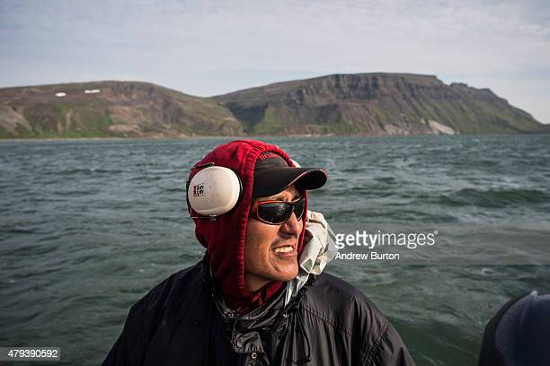 Joseph John Jr drives the boat while salmon fishing on July 1 2015 in Newtok Alaska Newtok has a population of approximately of 375 ethnically Yupik...