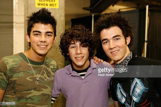 Joseph Jonas Nicholas Jonas and Kevin Jonas of The Jonas Brothers pose backstage at the Radio Disney Totally 10 Birthday Concert held at the...