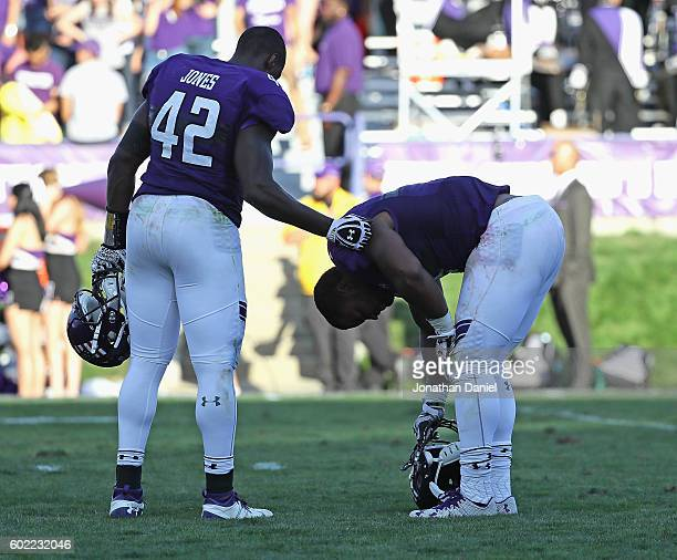 Joseph Jones and Anthony Walker Jr. #1 of the Northwestern Wildcats react after a loss to the Illinois State Redbirds at Ryan Field on September 10,...
