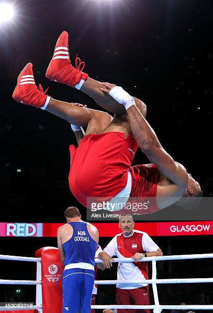 Joseph Joyce of England celebrates winning the gold medal against Joseph Goodall of Australia in the Men's Super Heavy Final at SSE Hydro during day...