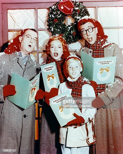 Joseph Kearns US actor Gloria Henry US actress Jay North US actor and Herbert Anderson US actor pose as a group of carol singers in a portrait issued...