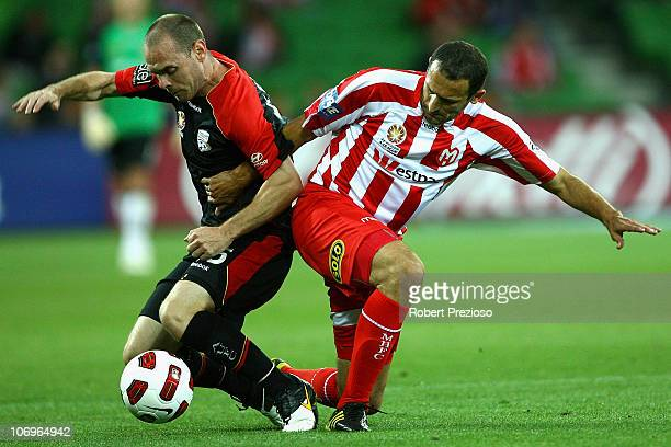 Joseph Keenan of Adelaide and Josip Skoko of the Heart contest the ball during the round 15 ALeague match between the Melbourne Heart and Adelaide...
