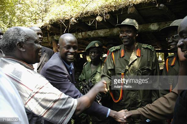 Joseph Kony head of the Lords Resistance Army that has fought a brutal twenty years war against the Ugandan government shakes hands with the...