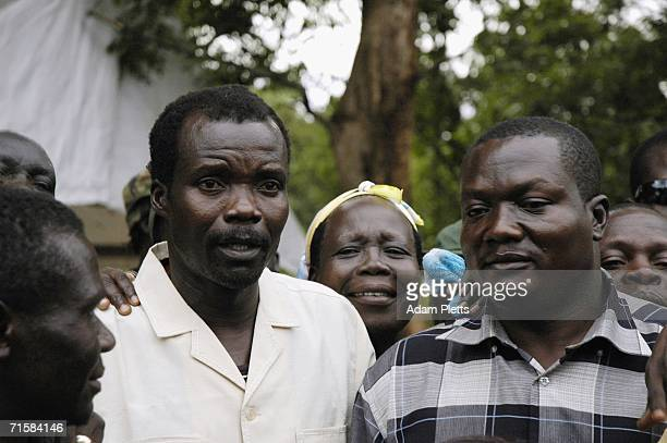 Joseph Kony leader of the Lords Resistance Army which has waged war with the Ugandan Government for twenty years stands next to Simon Toolit his...