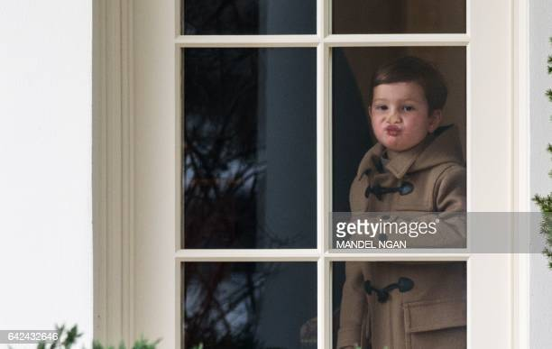 Joseph Kushner grandson of US President Donald Trump looks out of an Oval Office window before boarding Marine One from the South Lawn of the White...