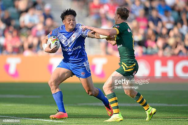 Joseph Leilua of Samoa is tackled during the Four Nations match between the Australian Kangaroos and Samoa at WIN Stadium on November 9 2014 in...