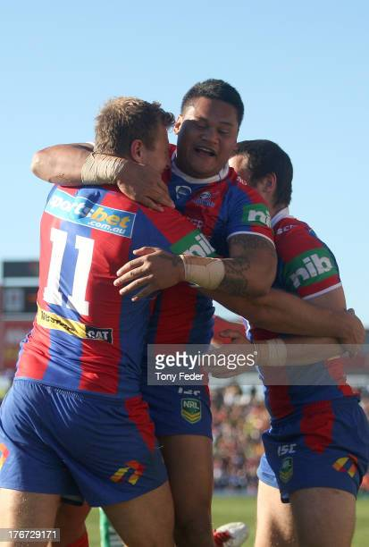 Joseph Leilua of the Knights celebrates a try with team mates during the round 23 NRL match between the Newcastle Knights and the Melbourne Storm at...