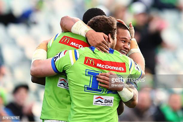 Joseph Leilua of the Raiders celebrates with team mates after scoring a try during the round 20 NRL match between the Canberra Raiders and the New...