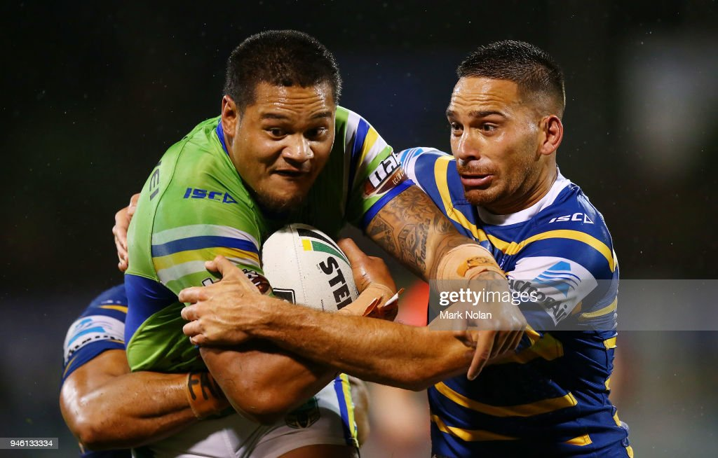 Joseph Leilua of the Raiders is tackled by Corey Norman of the Eels during the round six NRL match between the Canberra Raiders and the Parramatta Eels at GIO Stadium on April 14, 2018 in Canberra, Australia.