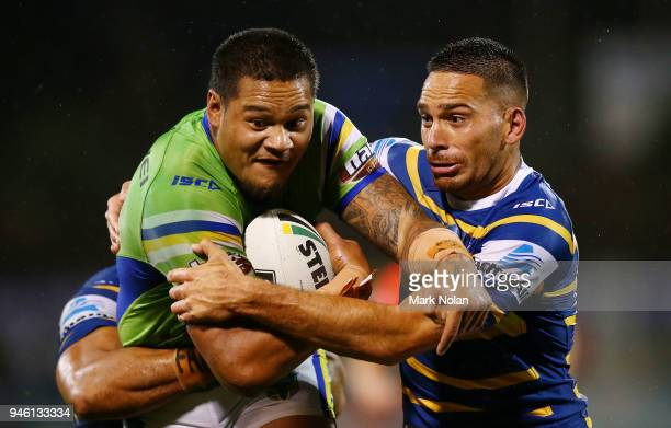 Joseph Leilua of the Raiders is tackled by Corey Norman of the Eels during the round six NRL match between the Canberra Raiders and the Parramatta...