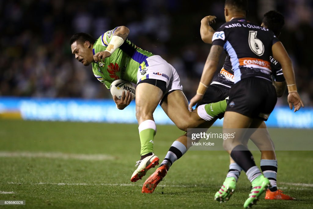 Joseph Leilua of the Raiders is tackled during the round 22 NRL match between the Cronulla Sharks and the Canberra Raiders at Southern Cross Group Stadium on August 5, 2017 in Sydney, Australia.
