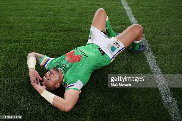 Joseph Leilua of the Raiders lays on the field dejected after the 2019 NRL Grand Final match between the Canberra Raiders and the Sydney Roosters at...