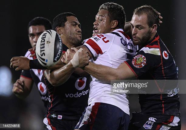 Joseph Leilua of the Roosters looses the ball in the tackle of Simon Mannering of the Warriors during the round 10 NRL match between the New Zealand...