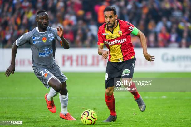 Joseph Lopy of Orleans and Walid Mesloub of Lens during the Ligue 2 match between Lens and US Orleans at Stade BollaertDelelis on May 17 2019 in Lens...