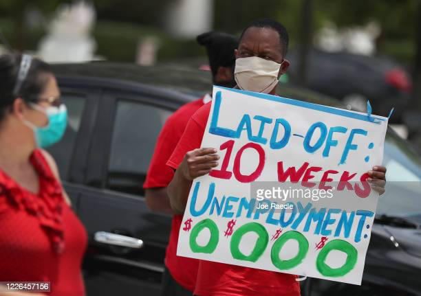 Joseph Louis joins others in a protest asking the state of Florida to fix its unemployment system on May 22 2020 in Miami Beach Florida Unemployed...