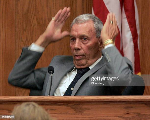 Joseph M Hatcher a former Meridian police officer and member of the Ku Klux Klan shows what the KKK's hats look like by gesturing while giving...