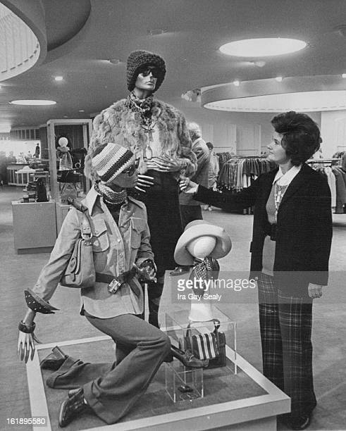 SEP 30 1972 OCT 1 1972 Joseph Magnin Remodels Major Store Eleanor Pomie of Joseph Magnin gives final examination to a display in the department store...