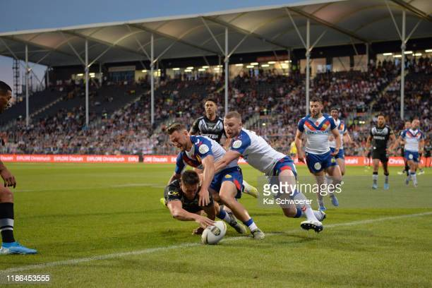 Joseph Manu of the Kiwis dives over to score a try during the Rugby League Test match between the New Zealand Kiwis and the Great Britain Rugby...