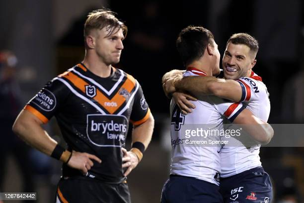 Joseph Manu of the Roosters celebrates after scoring a try with James Tedesco of the Roosters during the round 15 NRL match between the Wests Tigers...