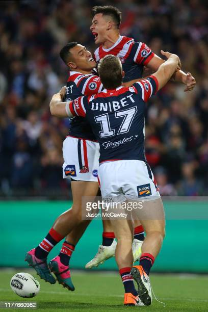 Joseph Manu of the Roosters celebrates with team mates prior to his try being disallowed during the NRL Preliminary Final match between the Sydney...