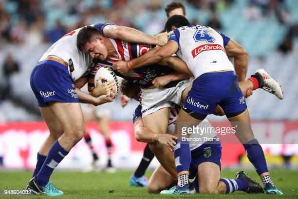 Joseph Manu of the Roosters is tackled by the Bulldogs defence during the round seven NRL match between the Canterbury Bulldogs and the Sydney...