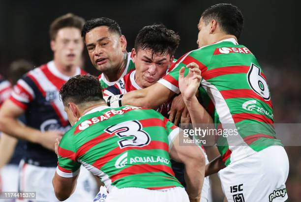 Joseph Manu of the Roosters is tackled during the NRL Qualifying Final match between the Sydney Roosters and the South Sydney Rabbitohs at Sydney...