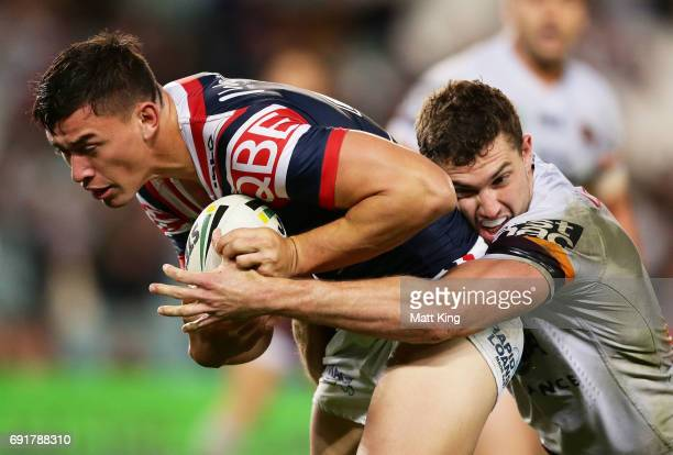 Joseph Manu of the Roosters is tackled during the round 13 NRL match between the Sydney Roosters and the Brisbane Broncos at Allianz Stadium on June...