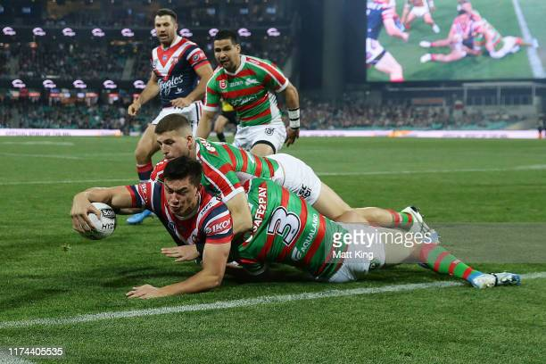 Joseph Manu of the Roosters scores a try during the NRL Qualifying Final match between the Sydney Roosters and the South Sydney Rabbitohs at Sydney...