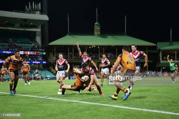 Joseph Manu of the Roosters scores athe final try during the round four NRL match between the Sydney Roosters and the Brisbane Broncos at Sydney...
