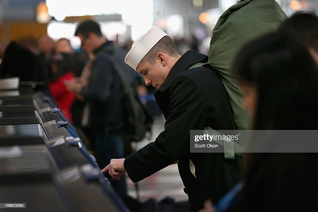 Joseph Maringo checks in for his flight home to Pittsburgh at O'Hare International Airport on December 21, 2012 in Chicago, Illinois. Today is the busiest air travel day of the Christmas holiday, with an estimated 200,000 travelers expected to travel through O'Hare today.