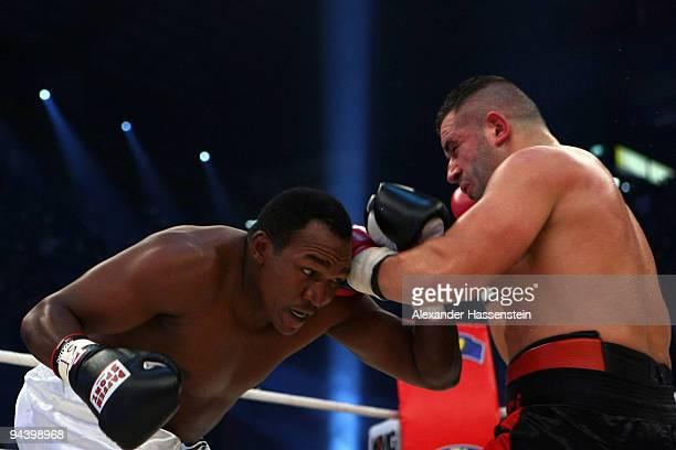 Joseph Marwa of Tanzania exchange punches with Nuri Seferi of Switzerland during their Cruiserweight fight at PostfinanceArena on December 12 2009 in...