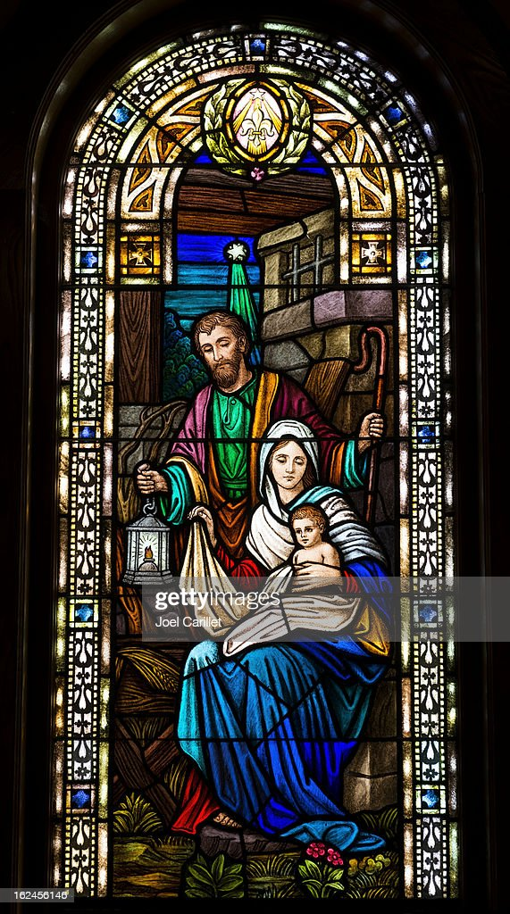 Joseph, Mary, and baby Jesus in stained glass : Stock Photo