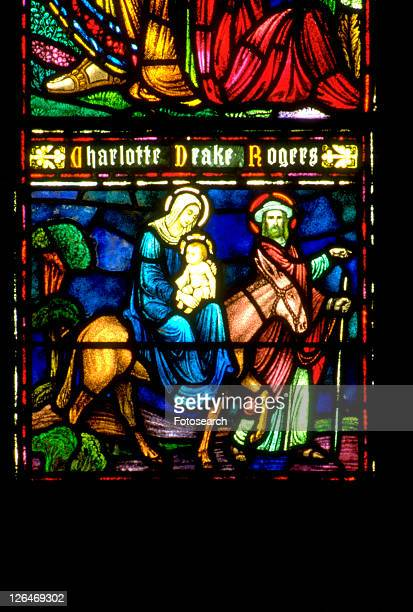 joseph mary and baby jesus traveling on donkey stained glass window - jesus riding on a donkey stock pictures, royalty-free photos & images