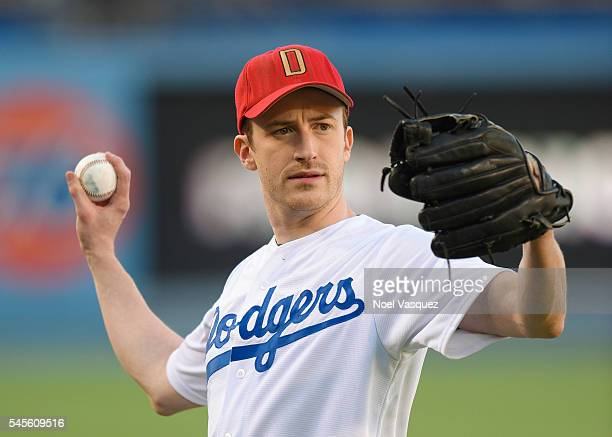 Joseph Mazzello throws out the ceremonial first pitch before a baseball game between the San Diego Padres and the Los Angeles Dodgers at Dodger...