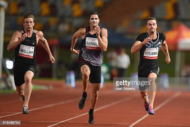 Joseph Millar of New Zealand Tom Gamble and Aaron Stubbs of Australia compete in the Mens 100 metres during the Queensland Track Classic on March 19...