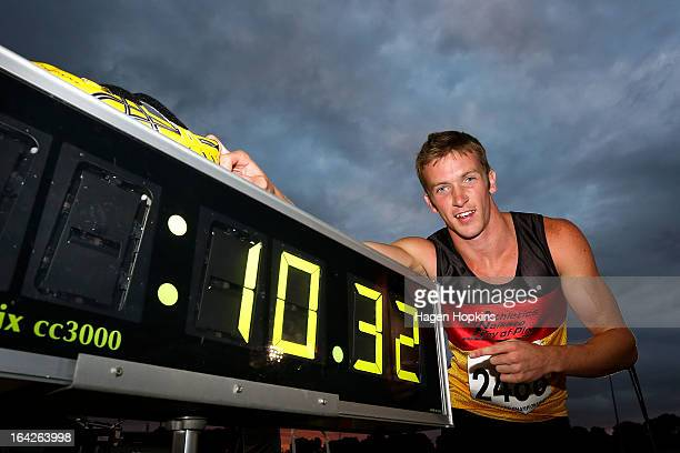 Joseph Millar of Waikato/BOP poses with his time after winning the senior men's 100m final during the New Zealand Track and Field Championships at Mt...