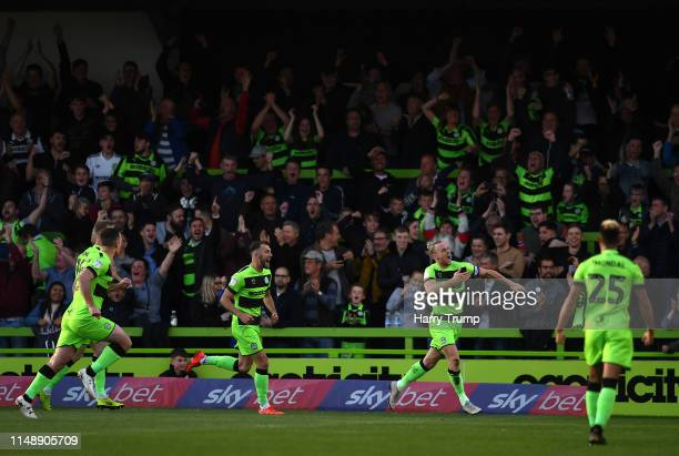 Joseph Mills of Forest Green Rovers celebrates scoring his side's first goa during the Sky Bet League Two Playoff Semi Final Second Leg match between...