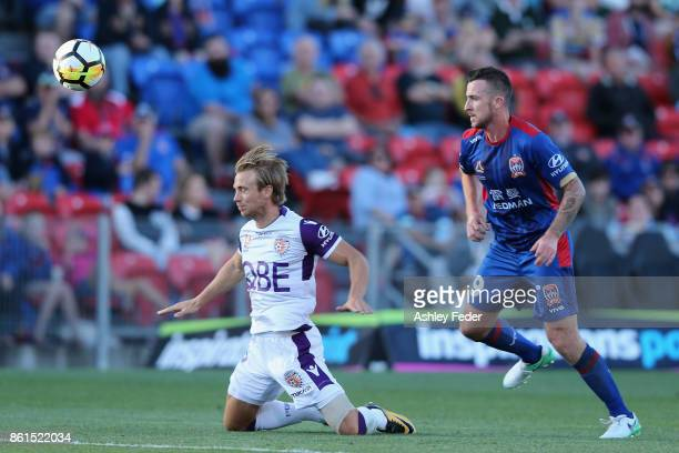 Joseph Mills of Perth Glory is contesed by Roy O'Donovan of the Jets during the round two ALeague match between the Newcastle Jets and Perth Glory at...
