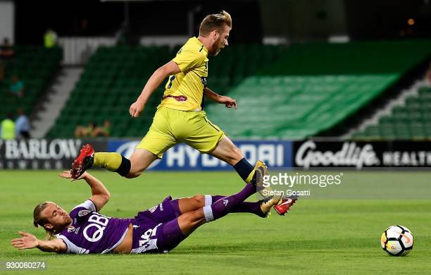 Joseph Mills of the Glory and Connor Pain of the Mariners collide during the round 22 ALeague match between the Perth Glory and the Central Coast...