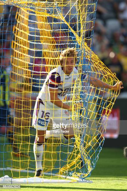 Joseph Mills of the Glory gets caught in the net during the round nine A-League match between the Central Coast Mariners and Perth Glory at Central...