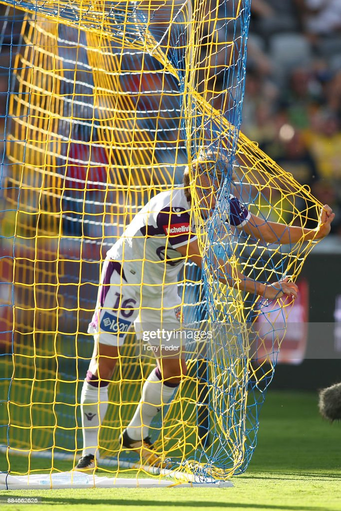 Joseph Mills of the Glory gets caught in the net during the round nine A-League match between the Central Coast Mariners and Perth Glory at Central Coast Stadium on December 3, 2017 in Gosford, Australia.
